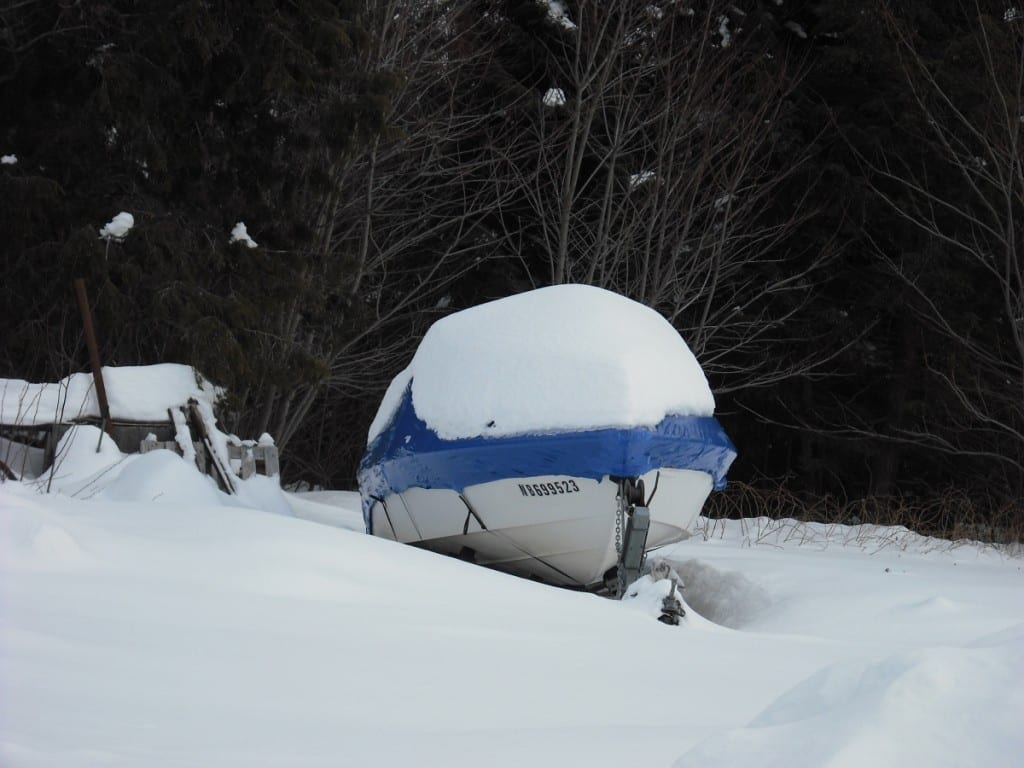 Shrink wrapping boats in snow