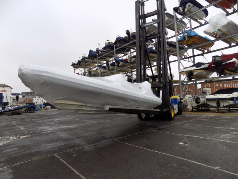 Shrink-wrapped RIB being stored in dry stacks