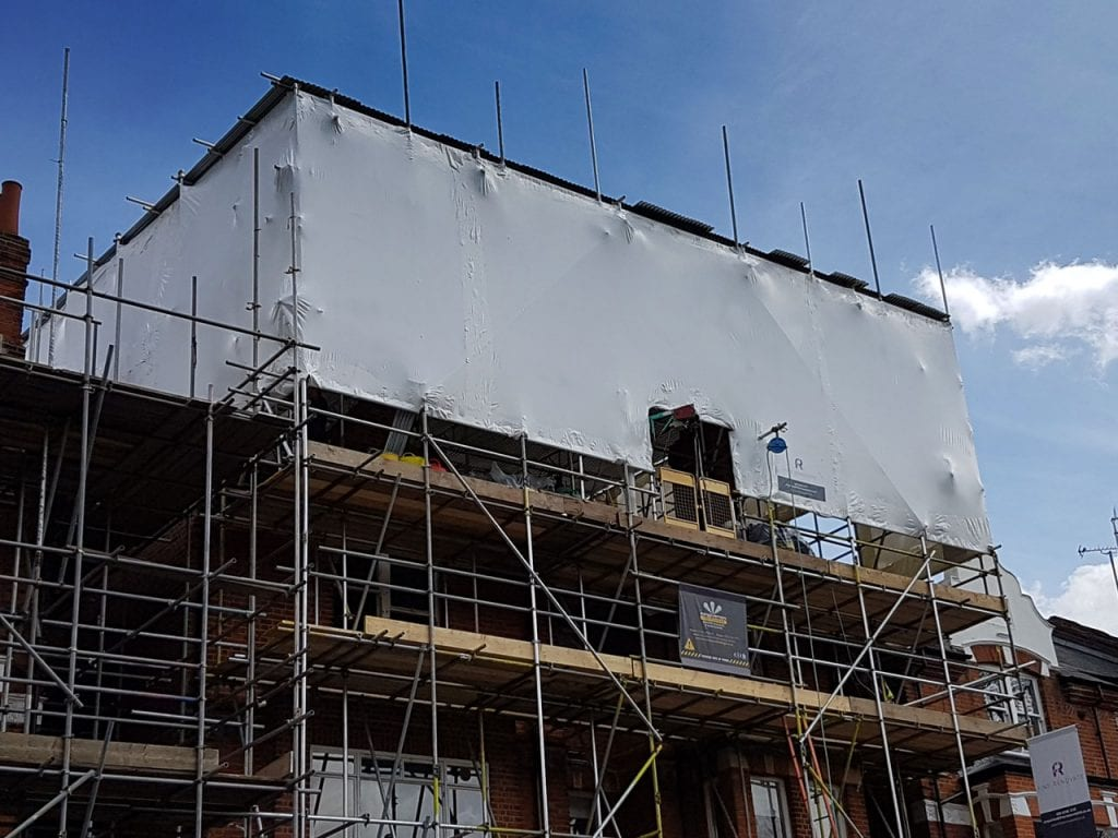 London project using shrink-wrap for protection and improved site appearance