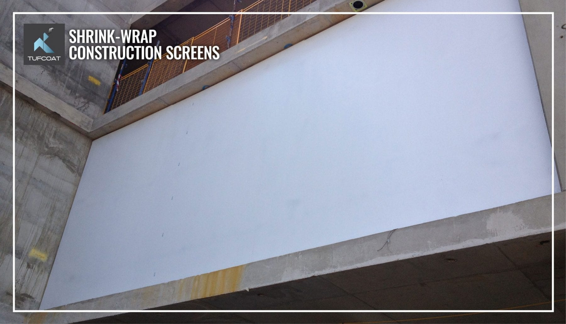 Shrink-wrap screen fixed to concrete building to weather proof during fit out
