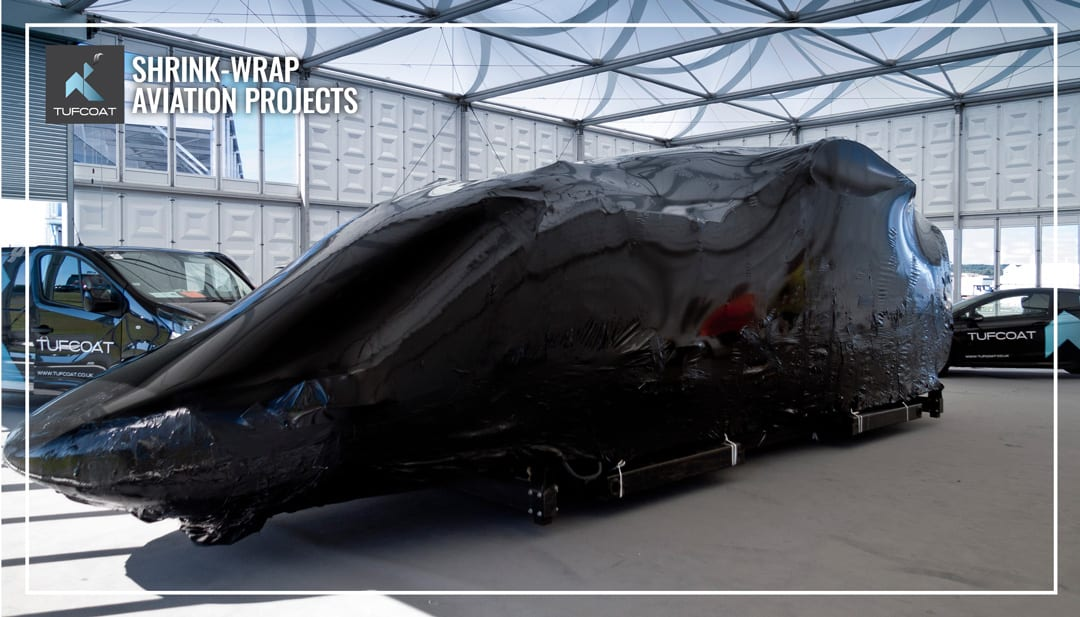 Helicopter shrink-wrapped in black
