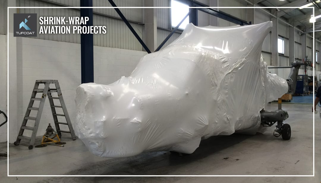 Helicopter shrink-wrapped for transport