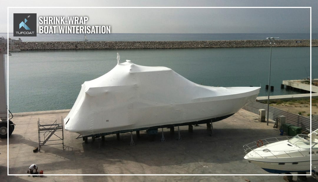 Motor yacht shrink-wrapped for storage during winter