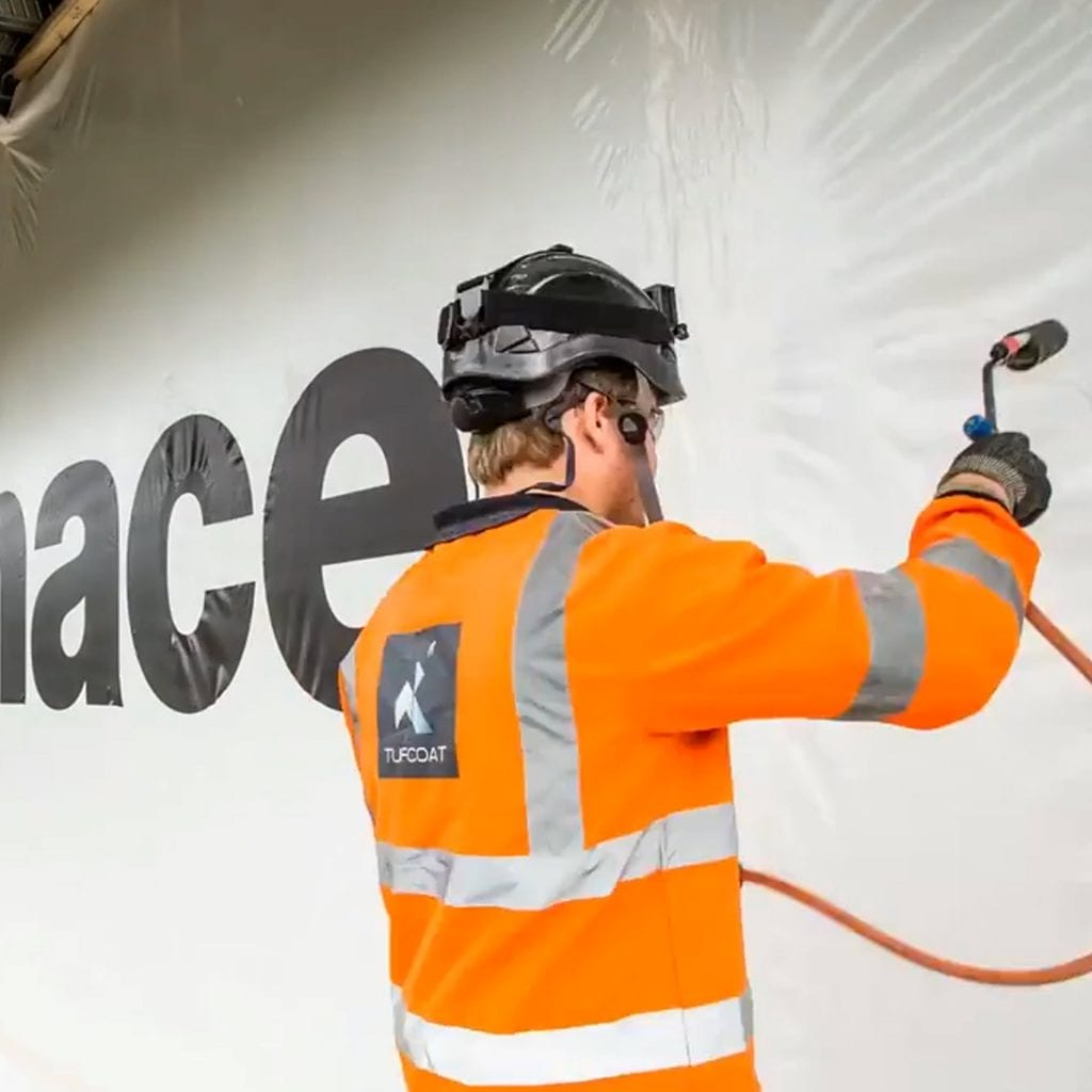 Shrink-wrap Construction Screen branded with MACE logo